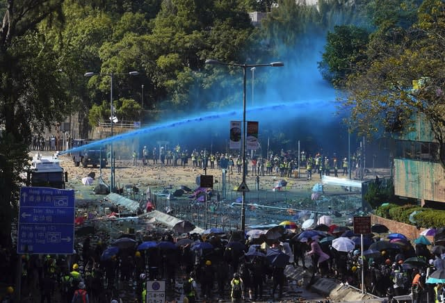 Police spray protesters with blue-dyed liquid