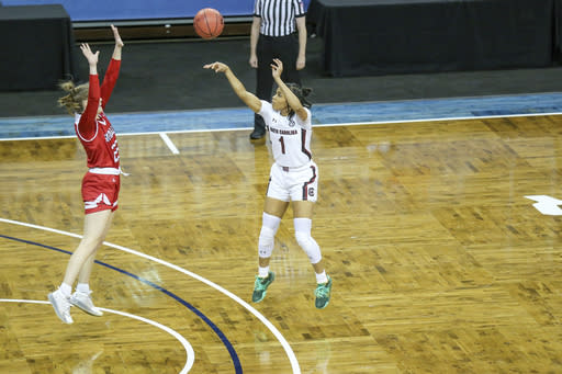 South Carolina guard Zia Cooke (1) shoots a 3-pointer over South Dakota defender Chloe Lamb (22) during the first half of an NCAA college basketball game on Saturday, Nov. 28, 2020, in Sioux Falls, S.D. (AP Photo/Josh Jurgens)