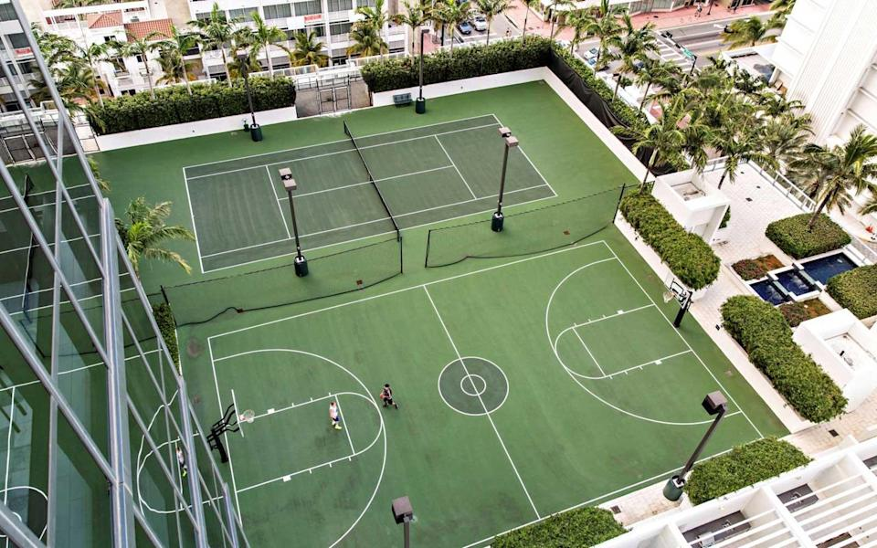 """<p>Guests at <a rel=""""nofollow noopener"""" href=""""http://www.wsouthbeach.com"""" target=""""_blank"""" data-ylk=""""slk:W South Beach"""" class=""""link rapid-noclick-resp"""">W South Beach</a> can arrange for private tennis or basketball lessons on the rooftop courts at this hotel, which also overlook the ocean. There are professional tennis and basketball coaches on staff for lessons.</p> <p>The hotel also has a newly launched wellness program with classes led by celebrity trainers. On the beachfront and oceanfront lawn, guests can take classes including Genius Body Work, Beach Boot Camp and Sunrise Yoga.</p>"""