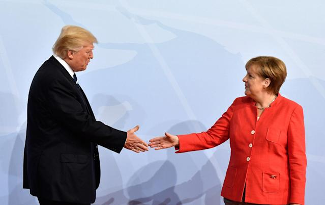 <p>German Chancellor Angela Merkel, right, greets President Donald Trump at the start of the G-20 meeting in Hamburg, northern Germany, on Friday, July 7, 2017. (Photo: John MacDougall/Pool Photo via AP) </p>