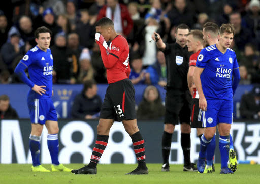 Southampton's Yan Valery, center, is sent off by Referee Michael Oliver during the English Premier League soccer match between Leicester City and Southampton at the King Power stadium, Leicester, England. Saturday, Jan. 12, 2019 (Mike Egerton/PA via AP)
