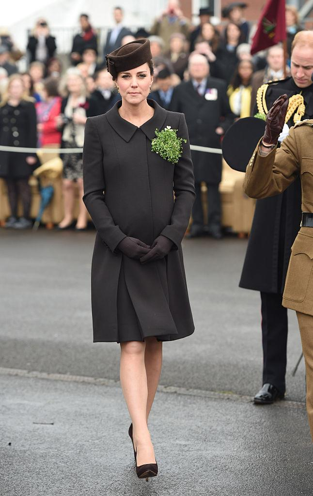 <p>Kate Middleton attended the St Patrick's Day Parade on March 17, 2015. Pregnant with Princess Charlotte, Kate dressed her bump in a Catherine Walker coat. <em>[Photo: Getty]</em> </p>
