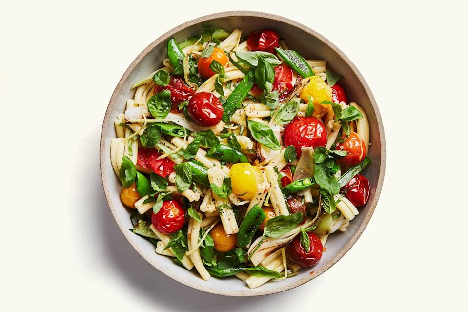 "Ginger-roasted cherry tomatoes, skillet-charred snap peas and scallions, and plenty of fresh basil and mint make this light take on pasta salad eminently craveable. <a href=""https://www.epicurious.com/recipes/food/views/pasta-salad-with-spring-vegetables-and-tomatoes?mbid=synd_yahoo_rss"" rel=""nofollow noopener"" target=""_blank"" data-ylk=""slk:See recipe."" class=""link rapid-noclick-resp"">See recipe.</a>"