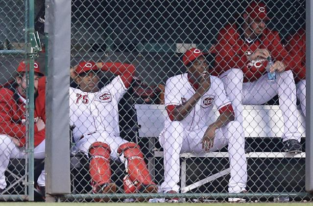 From left to right, Cincinnati Reds' Sam LeCure, Nilson Antigua, Aroldis Chapman and Logan Ondrusek sit in the bullpen in the fourth inning of a baseball game against the Colorado Rockies, Saturday, May 10, 2014, in Cincinnati. Chapman was activated early Saturday morning. (AP Photo/Al Behrman)