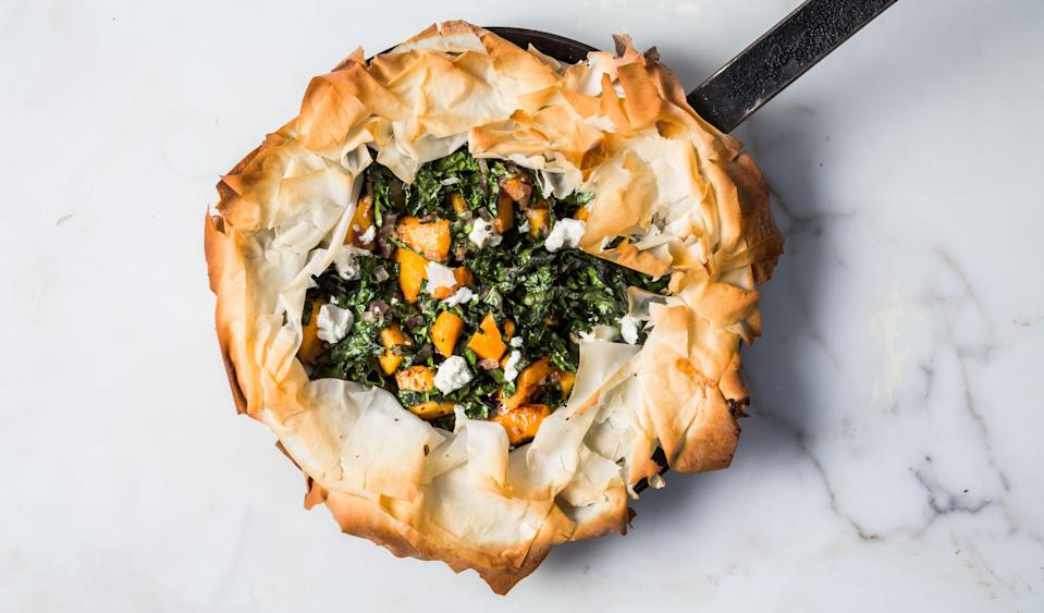 "When overlapping the phyllo over the filling in this recipe, work carefully but quickly so the phyllo doesn't dry out before baking. <a href=""https://www.bonappetit.com/recipe/skillet-phyllo-pie-with-butternut-squash-kale-and-goat-cheese?mbid=synd_yahoo_rss"" rel=""nofollow noopener"" target=""_blank"" data-ylk=""slk:See recipe."" class=""link rapid-noclick-resp"">See recipe.</a>"