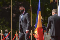 Polish President Andrzej Duda, left, walks with Romanian President Klaus Iohannis during the welcoming ceremony at the Cotroceni presidential palace in Bucharest, Romania, Monday, May 10, 2021. (AP Photo/Alexandru Dobre)