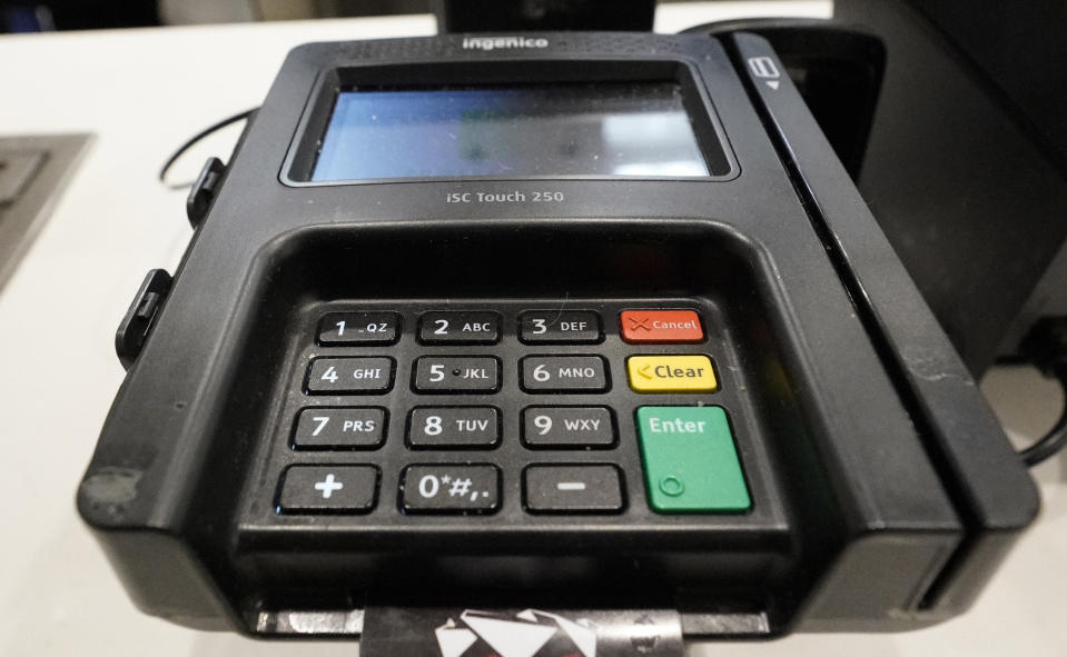 FILE- In this Jan. 29, 2019, file photo a credit card machine is shown at Mercedes-Benz Stadium during a tour for the NFL Super Bowl 53 football game in Atlanta. On Thursday, Feb. 7, the Federal Reserve releases its October report on consumer borrowing. (AP Photo/David J. Phillip, File)