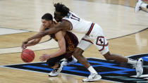 Loyola Chicago guard Lucas Williamson (1) and Illinois guard Ayo Dosunmu (11) chase a loose ball during the second half of a men's college basketball game in the second round of the NCAA tournament at Bankers Life Fieldhouse in Indianapolis, Sunday, March 21, 2021. (AP Photo/Paul Sancya)