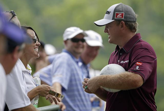 J. B. Holmes signs autographs during a practice round for the PGA Championship golf tournament at Valhalla Golf Club on Tuesday, Aug. 5, 2014, in Louisville, Ky. The tournament is set to begin on Thursday. (AP Photo/Jeff Roberson)