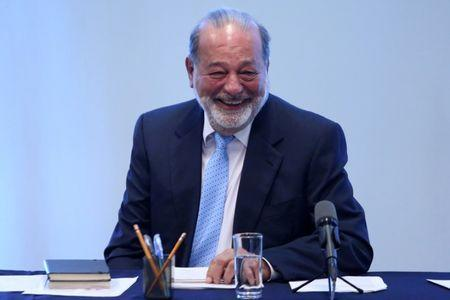 Mexican billionaire Carlos Slim smiles during a news conference in Mexico City