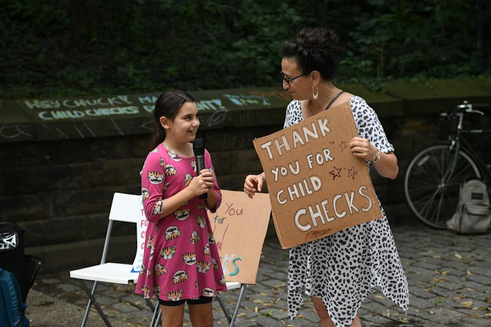 BROOKLYN, NEW YORK - JULY 12: Edie Abrams-Pradt and Jen Abrams celebrate new monthly Child Tax Credit payments and urge congress to make them permanent outside Senator Schumer's home on July 12, 2021 in Brooklyn, New York. (Photo by Bryan Bedder/Getty Images for ParentsTogether)