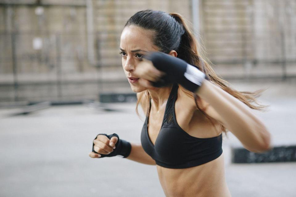 "<p>""This boxing move focuses on strengthening and targeting the chest. I love performing these at the end of a workout to get my heart rate up and release the last bit of energy I have!"" Dolke says.</p><p><strong>How to: </strong>Start standing in a proper boxing stance. Bend your left arm in a 90-degree angle and swing across your body like you are punching someone in the jaw. Rotate your hips for power, and pivot your knee as well. Then, repeat on the opposite arm. </p><p><strong>RELATED:</strong> <a href=""https://www.goodhousekeeping.com/health/fitness/g34980214/boxing-workout/"" rel=""nofollow noopener"" target=""_blank"" data-ylk=""slk:The Ultimate 30-Minute Boxing Workout to Help You Feel Great"" class=""link rapid-noclick-resp"">The Ultimate 30-Minute Boxing Workout to Help You Feel Great</a></p>"