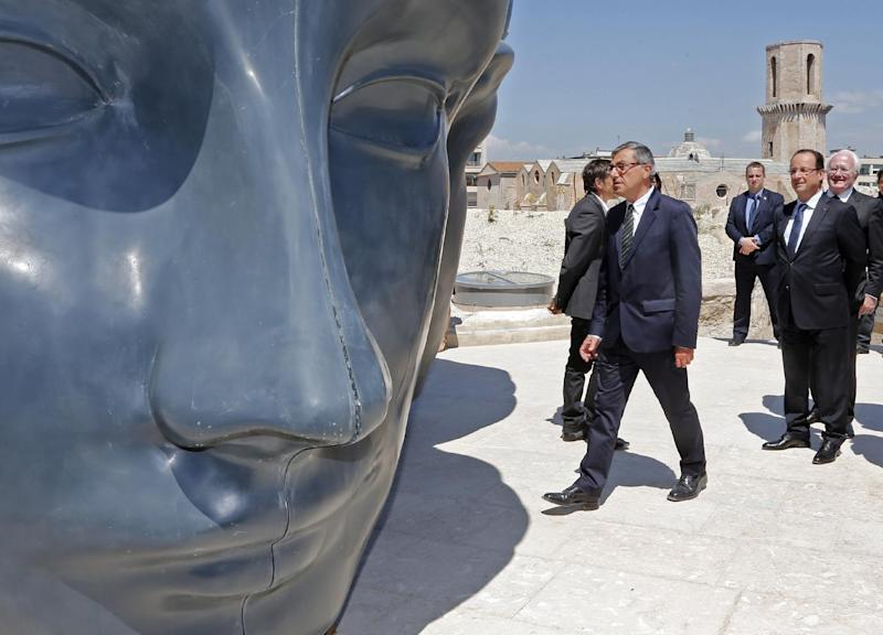 French President Francois Hollande, right, with MuCEM president Suzzarelli, center, seen during his visit to the Museum of Civilizations from Europe and the Mediterranean (MuCEM) in Marseille, southern France, Tuesday June 4, 2013. The museum that cost over 200 million euros ($260 million), was inaugurated by French President Francois Hollande on Tuesday, and is the center piece of Marseille's turn as the European Capital of Culture for 2013, which aims to attract 10 million visitors this year.  (AP Photo/Jean-Paul Pelissier, Pool)