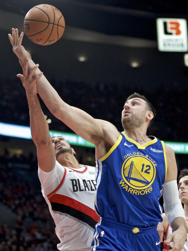 Golden State Warriors center Andrew Bogut, right, is fouled by Portland Trail Blazers center Enes Kanter during the first half of Game 3 of the NBA basketball playoffs Western Conference finals Saturday, May 18, 2019, in Portland, Ore. (AP Photo/Craig Mitchelldyer)