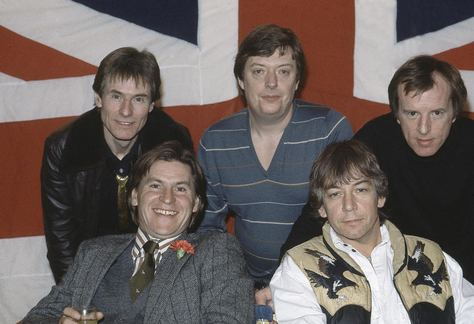 FILE - In this April 7, 1983 file photo, British pop group The Animals, from left, Hilton Valentine, Chas Chandler, John Steel, front row, Alan Price, and Eric Burdon, pose for photographers after announcing plans for a world tour, in London, England. Hilton Valentine, the founding guitarist of English rock and roll band The Animals who is credited with coming up with one of the most famous opening riffs of the 1960s, has died. He was 77. The band's label ABKCO Music confirmed that Valentine died on Friday, Jan. 29, 2021 saying it was informed of the death by his wife Germaine Valentine. (AP Photo, File)