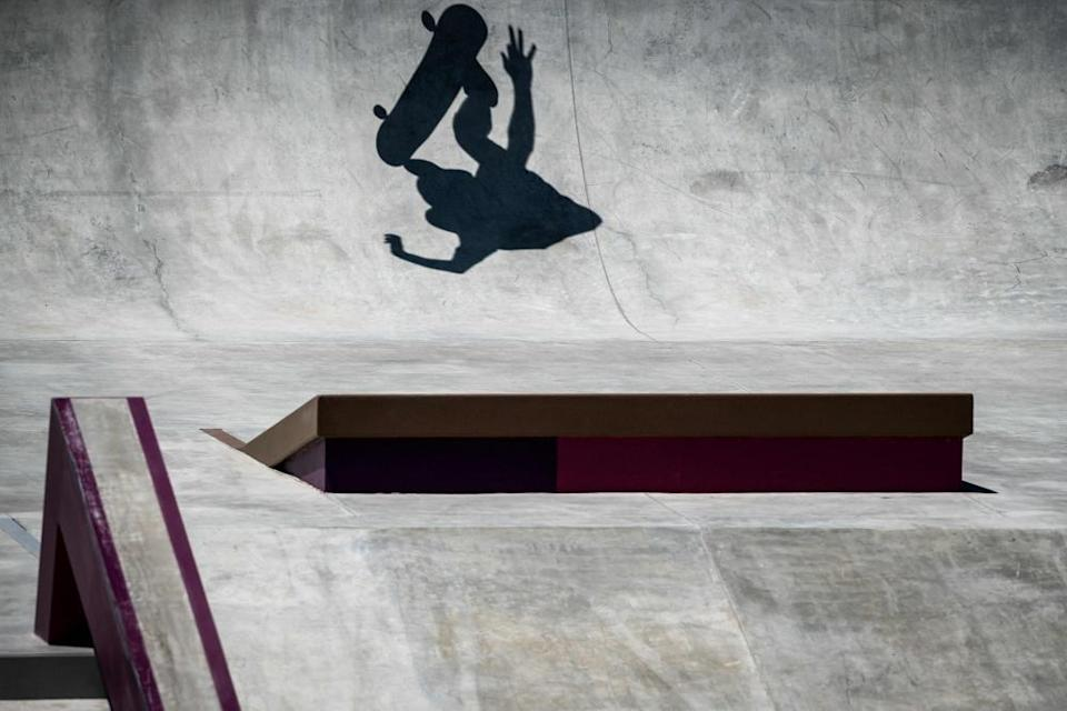 The shadow of a skateboarder is seen during a practice session at Ariake Urban Sports Park in Tokyo.