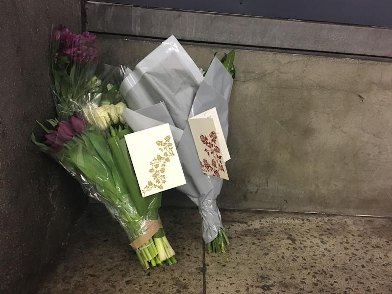 <strong>Flowers and cards from Labour leader Jeremy Corbyn and his staff, left by a member of his team at the underpass of exit three at Westminster Underground station</strong> (PA Wire/PA Images)