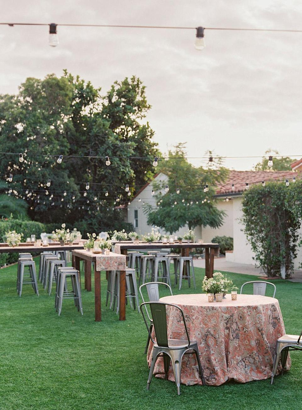 <p>The couple invited all of their guests to the welcome party, which took place after the rehearsal dinner on the hotel's lawn. Bar stool tables were flanked by two lounge areas with Adirondack chairs and clusters of lanterns. Guests mingled and enjoyed food stations, cocktails, and a table of desserts. </p>