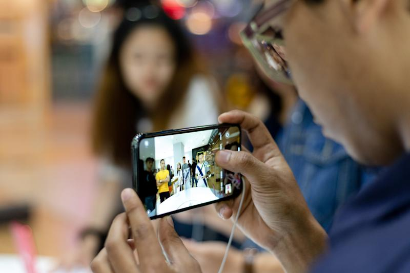 A customer takes a photograph with an iPhone 11 Pro at Apple store during a product launch event in Kuala Lumpur, Malaysia on Friday, September 27, 2019. Apple's new iPhones with camera enhancements and improved battery life go on sale today. (Photo by Chris Jung/NurPhoto via Getty Images)