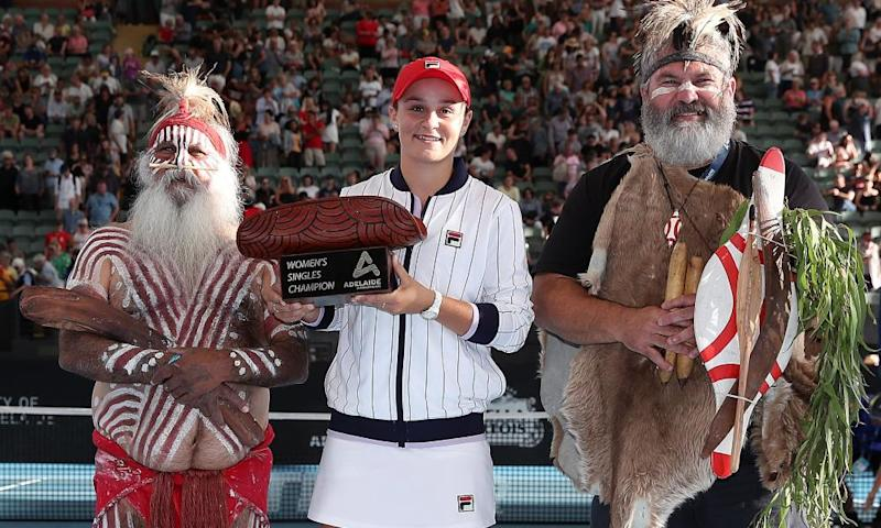 Ashleigh Barty of Australia poses with the trophy with Aboriginal elders Major Sumner and Mickey Kumatpi O'Brien