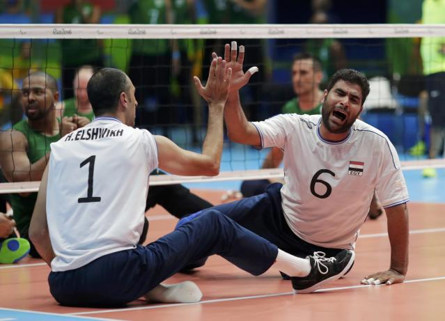 2016 Rio Paralympics - Sitting Volleyball - Men's Bronze Medal Match - Riocentro Pavilion 6 - Rio de Janeiro, Brazil - 18/09/2016. Hesham Elshwikh and Ahmed Soliman (EGY) of Egypt celebrate. REUTERS/Ueslei Marcelino FOR EDITORIAL USE ONLY. NOT FOR SALE FOR MARKETING OR ADVERTISING CAMPAIGNS.