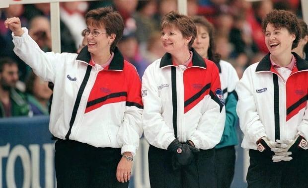 Curlers Sandra Schmirler, left, Jan Betker, centre and Joan McCusker planned their pregnancies so they could successfully win gold at the 1998 Olympics in Nagano, Japan.