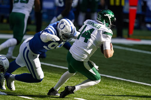 Indianapolis Colts defensive tackle DeForest Buckner (99) pressures New York Jets quarterback Sam Darnold (14) In the first half of an NFL football game in Indianapolis, Sunday, Sept. 27, 2020. (AP Photo/Darron Cummings)