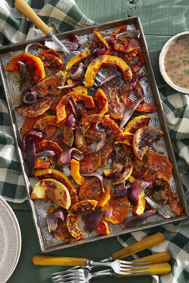 """<p>A homemade vinaigrette made with apple cider, whole-grain mustard, and red wine vinegar adds some tang to this dish.</p><p><strong><a href=""""https://www.countryliving.com/food-drinks/a23367748/roasted-butternut-squash-with-cider-vinaigrette-recipe/"""" target=""""_blank"""">Get the recipe</a>.</strong></p><p><strong><a class=""""body-btn-link"""" href=""""https://www.amazon.com/Nordic-Ware-Natural-Aluminum-Commercial/dp/B0049C2S32?tag=syn-yahoo-20&ascsubtag=%5Bartid%7C10050.g.1553%5Bsrc%7Cyahoo-us"""" target=""""_blank"""">SHOP BAKING SHEETS</a><br></strong></p>"""