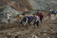 The disaster struck after heavy rainfall pounded the open-cast mines in Myanmar's north