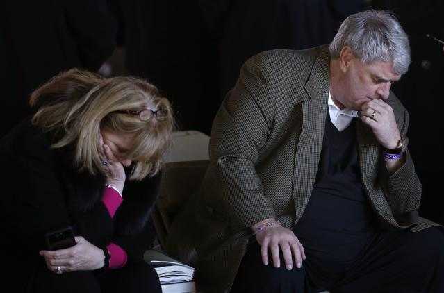 <p>India and Greg Keith, family friends of the Grahams, pray before the funeral service for the late U.S. evangelist Billy Graham at the Billy Graham Library in Charlotte, N.C., March 2, 2018. (Photo: Leah Millis/Reuters) </p>