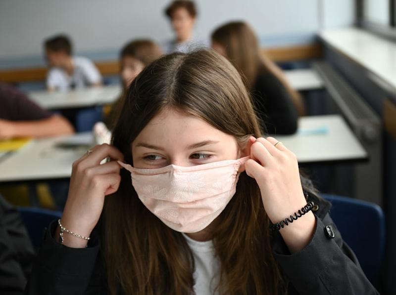 Secondary school staff and pupils in parts of England will now have to wear face coverings. (Image posed by models, Getty Images)