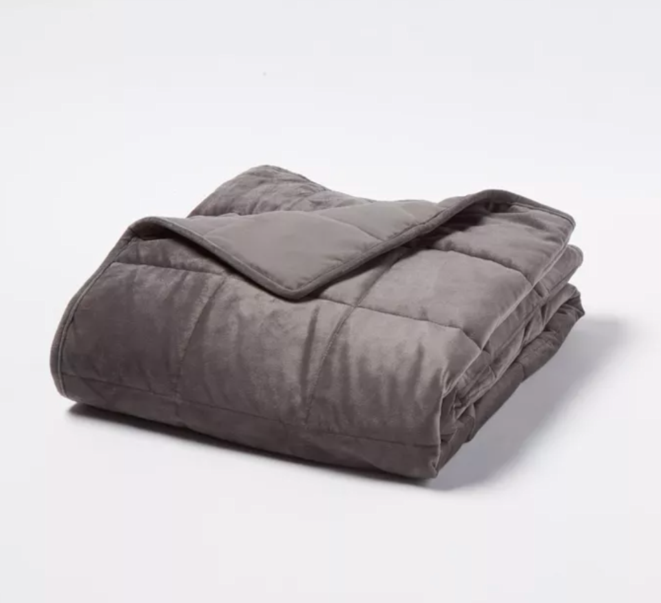 """<h3>Tranquility Weighted Throw Blanket</h3><br>This under-$50, glass bead-filled style boasts a box-quilt design and 12 lbs. of comforting DTP (Deep Touch Pressure) meant to simulate 8% to 12% body weight. <br><br><strong>The hype:</strong> 4.5 out of 5 stars and 1,429 reviews on <a href=""""https://www.target.com/p/12lbs-weighted-throw-blanket-gray-tranquility/-/A-53691535"""" rel=""""nofollow noopener"""" target=""""_blank"""" data-ylk=""""slk:Target"""" class=""""link rapid-noclick-resp"""">Target</a><br><br><strong>What they're saying: </strong>""""I can't believe I waited so long to buy this! Wonderfully affordable alternative to other (very expensive) weighted blankets out there. I've been them all for a while, but I was worried about them being too heavy (I'm ~155 - 160) or too hot (I live in a HOT humid city on the Gulf Coast). Not the case! The 15lb blanket is a perfect soothing, but not restricting weight. According to my sleep tracker app, I've been falling asleep much faster! And despite the August heat, I've been comfortable under the blanket all night."""" <em>– Sarah, Target reviewer</em><br><br><strong>Tranquility</strong> 12lbs Weighted Throw Blanket, $, available at <a href=""""https://go.skimresources.com/?id=30283X879131&url=https%3A%2F%2Fwww.target.com%2Fp%2F12lbs-weighted-throw-blanket-gray-tranquility%2F-%2FA-53691535"""" rel=""""nofollow noopener"""" target=""""_blank"""" data-ylk=""""slk:Target"""" class=""""link rapid-noclick-resp"""">Target</a>"""