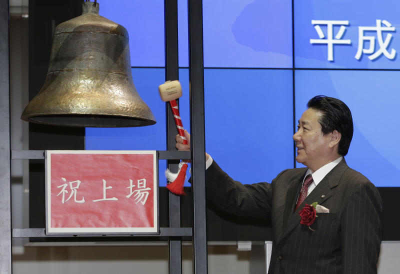Japan Airlines President Yoshiharu Ueki rings a bell during a ceremony to mark its relisting on the Tokyo Stock Exchange in Tokyo, Wednesday, Sept. 19, 2012.   Japan Airlines Co. capped an $8.5 billion initial public offering, the biggest this year after Facebook's, with a modest return to the Tokyo Stock Exchange: Its share price rose only 1 percent in the first day of trading. (AP Photo/Shizuo Kambayashi)