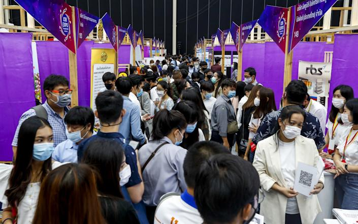 Job seekers look at offers at the Job Expo Thailand 2020 in Bangkok, Thailand - Shutterstock