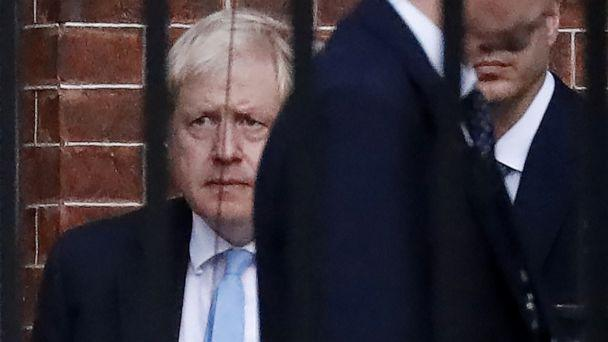 PHOTO: Britain's Prime Minister Boris Johnson (L) leaves from the rear of 10 Downing Street in central London on October 16, 2019. (Tolga Akmen/AFP via Getty Images)