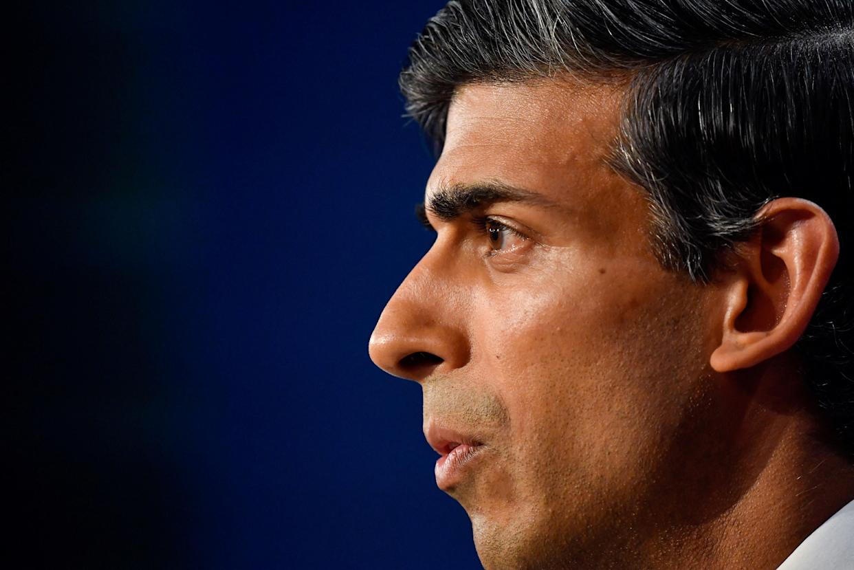 Britain's Chancellor of the Exchequer Rishi Sunak attends a press conference inside the Downing Street Briefing Room in central London on September 7, 2021. - Breaking an election pledge not to raise taxes, British Prime Minister Boris Johnson on Tuesday announced hefty new funding to fix a social care crisis and a pandemic surge in hospital waiting lists. (Photo by TOBY MELVILLE / POOL / AFP) (Photo by TOBY MELVILLE/POOL/AFP via Getty Images)