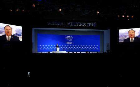 Borge Brende, President of World Economic Forum stands on a stage while U.S. Secretary of State Mike Pompeo is seen on screens as he addresses attendees via satellite, during the World Economic Forum (WEF) annual meeting in Davos, Switzerland, January 22, 2019. REUTERS/Arnd Wiegmann