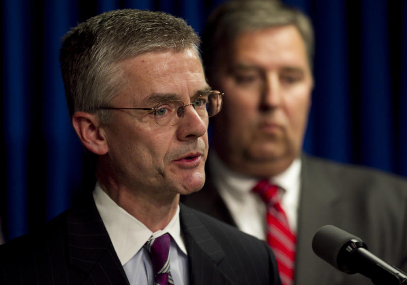 Richard Deslauriers, FBI special agent in charge of the Boston Field Office, left, faces reporters as James Trusty, chief of the organized crime and gang section in the U.S. Justice Department Criminal Devision, right, looks on during a news conference in Providence, R.I., Wednesday, April 25, 2012, held to announce the arrest of alleged New England mafia boss Anthony DiNunzio. The investigation into the alleged shakedown of Providence strip clubs left the New England mafia without a leader on Wednesday as authorities arrested the reputed boss in Boston on charges he oversaw the mob's extortion of adult entertainment businesses and sought to broaden its influence.  (AP Photo/Steven Senne)