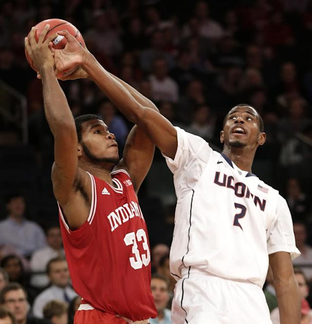 Indiana's Jeremy Hollowell, left, fights for a rebound with Connecticut's DeAndre Daniels during the first half of an NCAA college basketball game on Friday, Nov. 22, 2013, in New York. (AP Photo/Seth Wenig)