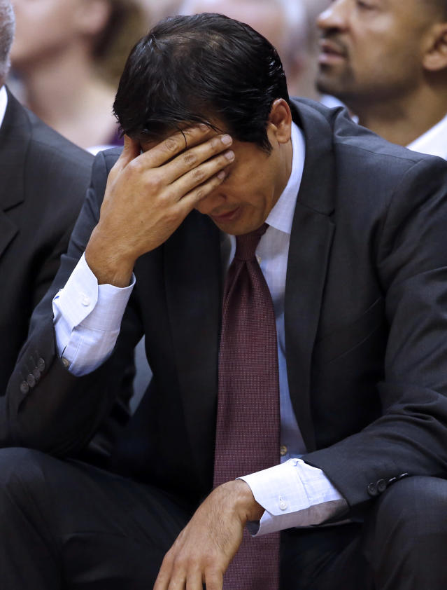 Miami Heat head coach Erik Spoelstra holds his head in the second half of an NBA basketball game against the Washington Wizards, Monday, April 14, 2014, in Washington. The Wizards won 114-93. (AP Photo/Alex Brandon)