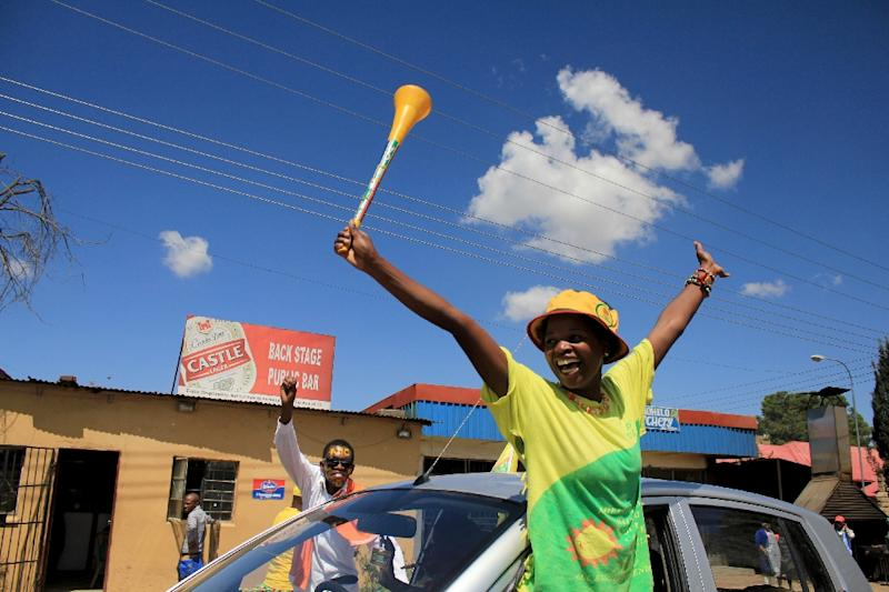 People cheer on March 17, 2015 during the inauguration ceremony of the new prime minister in Maseru (AFP Photo/Hlompho Letsielo)