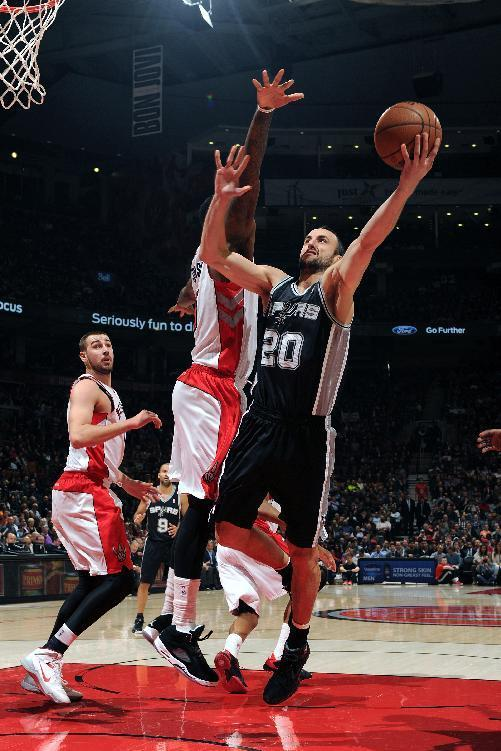 TORONTO, CANADA - December 10: Manu Ginobili #20 of the San Antonio Spurs drives to the basket against the Toronto Raptors on December 10, 2013 at the Air Canada Centre in Toronto, Ontario, Canada. (Photo by Ron Turenne/NBAE via Getty Images)