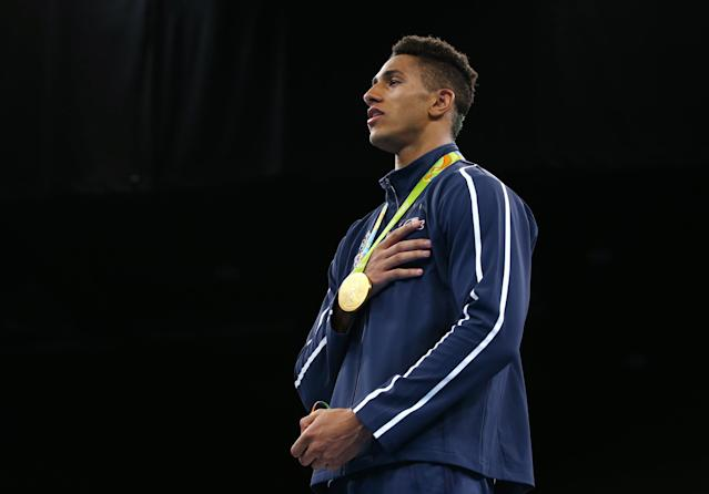 2016 Rio Olympics - Boxing - Victory Ceremony - Men's Super Heavy (+91kg) Victory Ceremony - Riocentro - Pavilion 6 - Rio de Janeiro, Brazil - 21/08/2016. Gold medallist Tony Yoka (FRA) of France sings the national anthem. REUTERS/Peter Cziborra FOR EDITORIAL USE ONLY. NOT FOR SALE FOR MARKETING OR ADVERTISING CAMPAIGNS.