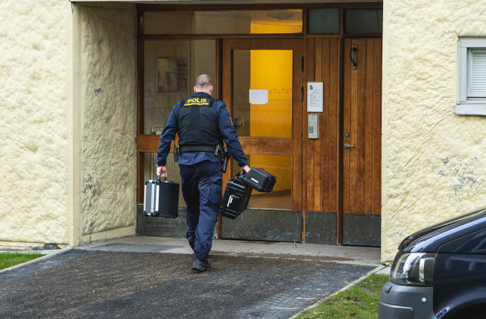 Police at the scene of an apartment where a woman is suspected of locking up her son, in Haninge, south of Stockholm, Tuesday, Dec. 1, 2020. Police in Stockholm are investigating a woman in her 70s for locking up her son for 28 years in an apartment south of the Swedish capital, investigators said Tuesday. Prosecutor Emma Olsson, who heads the preliminary investigation, said the woman who was arrested Monday, was held on suspicion of unlawful deprivation of liberty and grievous bodily harm. (Claudio Bresciani/TT via AP)