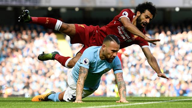 <p>Nicholas Otamendi and Mo Salah come crashing to the ground </p>