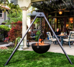 """<p><strong>Cowboy Cauldron</strong></p><p>cowboycauldron.com</p><p><strong>$999.00</strong></p><p><a href=""""https://cowboycauldron.com/products/the-dude"""" rel=""""nofollow noopener"""" target=""""_blank"""" data-ylk=""""slk:Shop Now"""" class=""""link rapid-noclick-resp"""">Shop Now</a></p><p>Why not soak up the great outdoors with a legit open-air fire? It comes with all the accoutrements including a cooking grill, charcoal grate, and tripod frame. At 35 lbs, it's made to travel. </p>"""