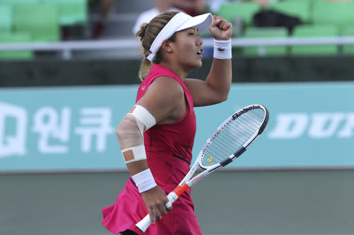 Kristie Ahn of the United States reacts after winning a point against Ana Bogdan of Romania during their second round match of the Korea Open tennis championships in Seoul, South Korea, Wednesday, Sept. 18, 2019. (AP Photo/Ahn Young-joon)