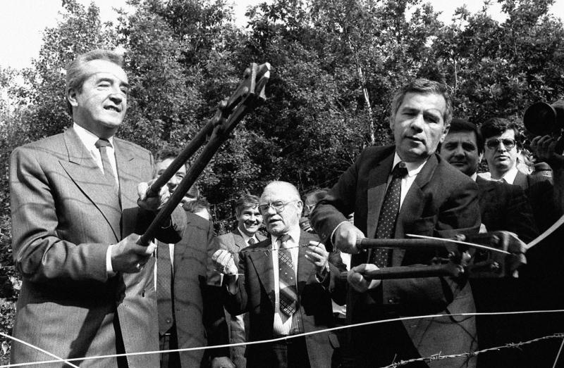 FILE - Photo taken on June 27, 1989 on Foreign Ministers Gyula Horn, right, of Hungary and Alois Mock, left, of Austria cutting the barbed wire fence on the Hungarian-Austrian border thus taking part in the destruction of the iron curtain between Hungary and Austria at Fertorakos, Hungary. Gyula Horn, a former Hungarian prime minister who played a key role in opening the Iron Curtain, has died at the age of 80. Horn's death on Wednesday was announced by the Hungarian government and confirmed by the Socialist Party, which he led to victory in the 1994 elections. (AP Photo/MTI, Karoly Matusz)