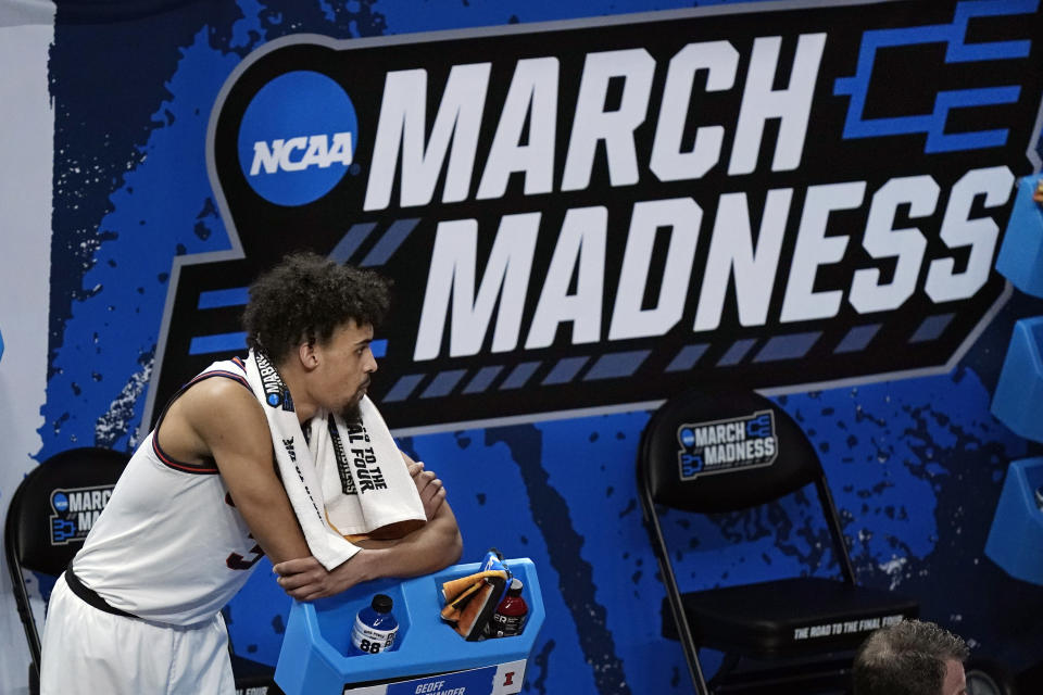 Illinois' Jacob Grandison watches the final moments of Illinois' loss to Loyola of Chicago in a college basketball game in the second round of the NCAA tournament at Bankers Life Fieldhouse in Indianapolis Sunday, March 21, 2021. Loyola upset Illinois 71-58. (AP Photo/Mark Humphrey)