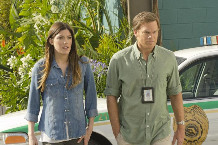 """This undated publicity image released by Showtime shows Jennifer Carpenter as Debra Morgan, left, and Michael C. Hall as Dexter Morgan in a scene from """"Dexter."""" (AP Photo/Showtime, Randy Tepper)"""